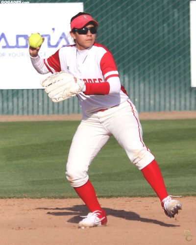 Female player throwing softball.