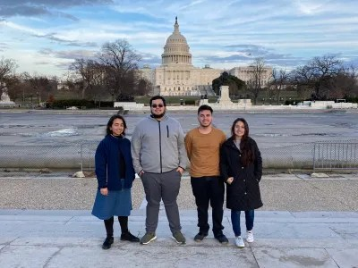 Four students in front of the capital building.
