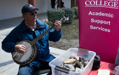 Jack playing his banjo at an Academic Support services event.