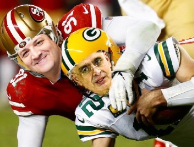 San Francisco 49er with Zav's face tackling a Green Bay pack with Mike face.
