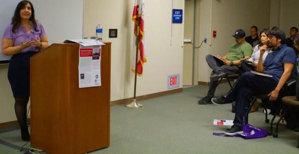 Lori Flores speaks in the Levan Center.