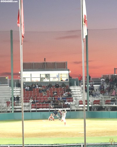 Softball game against sunset.