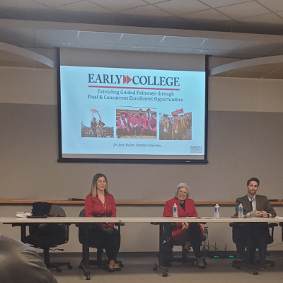 Panel in front of Early College slide.