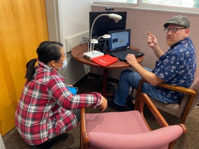Eddie Ledbetter works with a faculty member to get their virtual workstation ready.