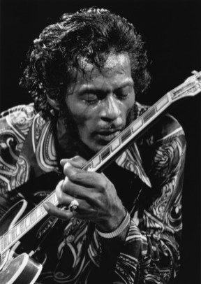 Chuck Berry kissing his guitar on stage at the Rock & Roll Revival concert at MSG, NYC. October 1971. © Bob Gruen / www.bobgruen.com Please contact Bob Gruen's studio to purchase a print or license this photo. email: websitemail01@aol.com phone: 212-691-0391