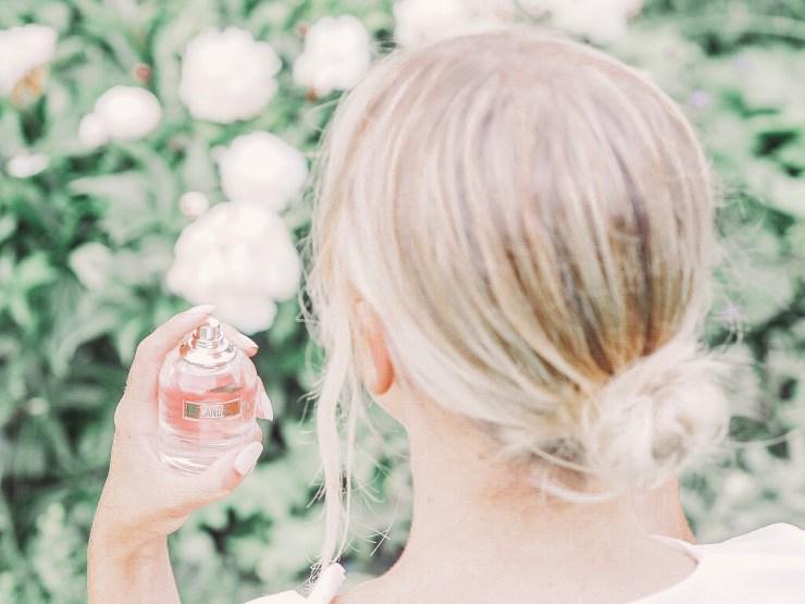 Spraying Scandal perfume