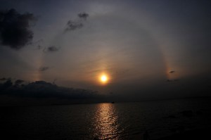 Halo around the Sun over the water [image from U.S. NASA 'Weather Trickery']