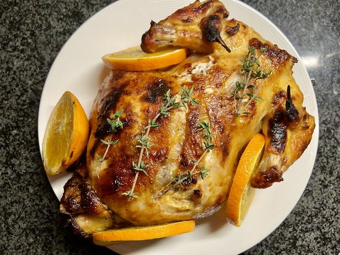 Kip met sinaasappel, honing en tijm uit de oven