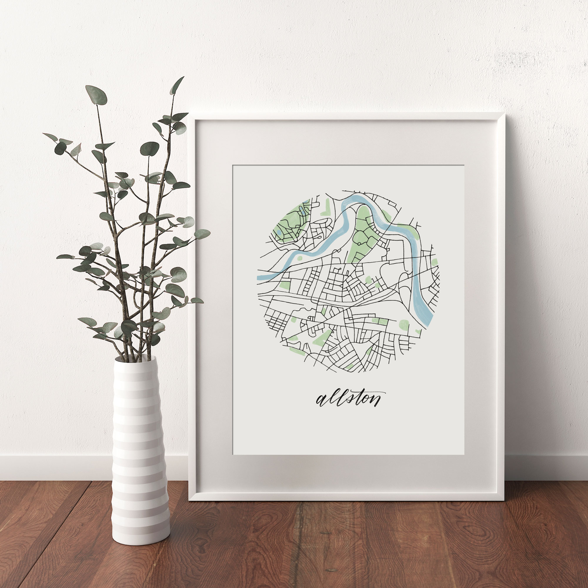 Allston, Boston Map print framed and leaning on white wall next to dried leaves in a vase