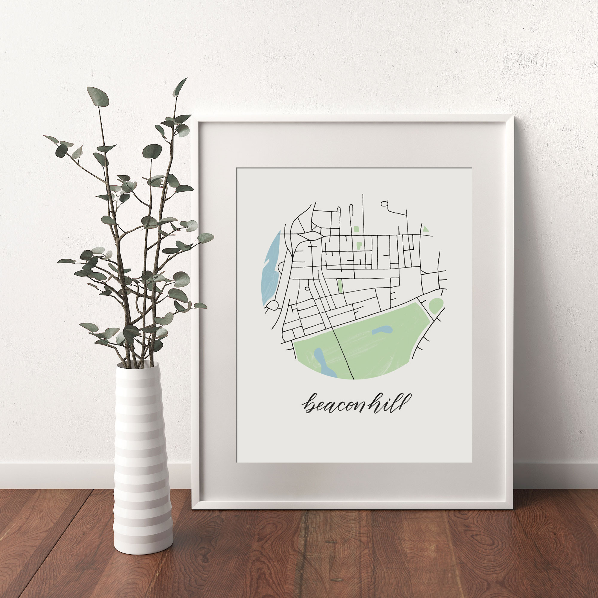 Beacon Hill, Boston Map print framed and leaning on white wall next to dried leaves in a vase