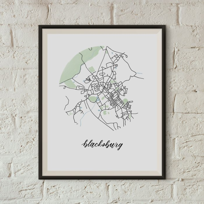 Blacksburg Map Print framed on a white brick wall