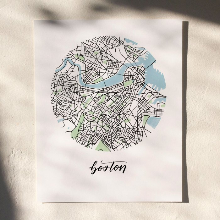 Boston Map Print hanging on white wall with leaf shadows across the image