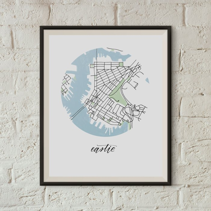 Eastie, Boston Map Print framed on a white brick wall