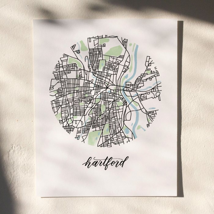Hartford Map Print hanging on white wall with leaf shadows across the image