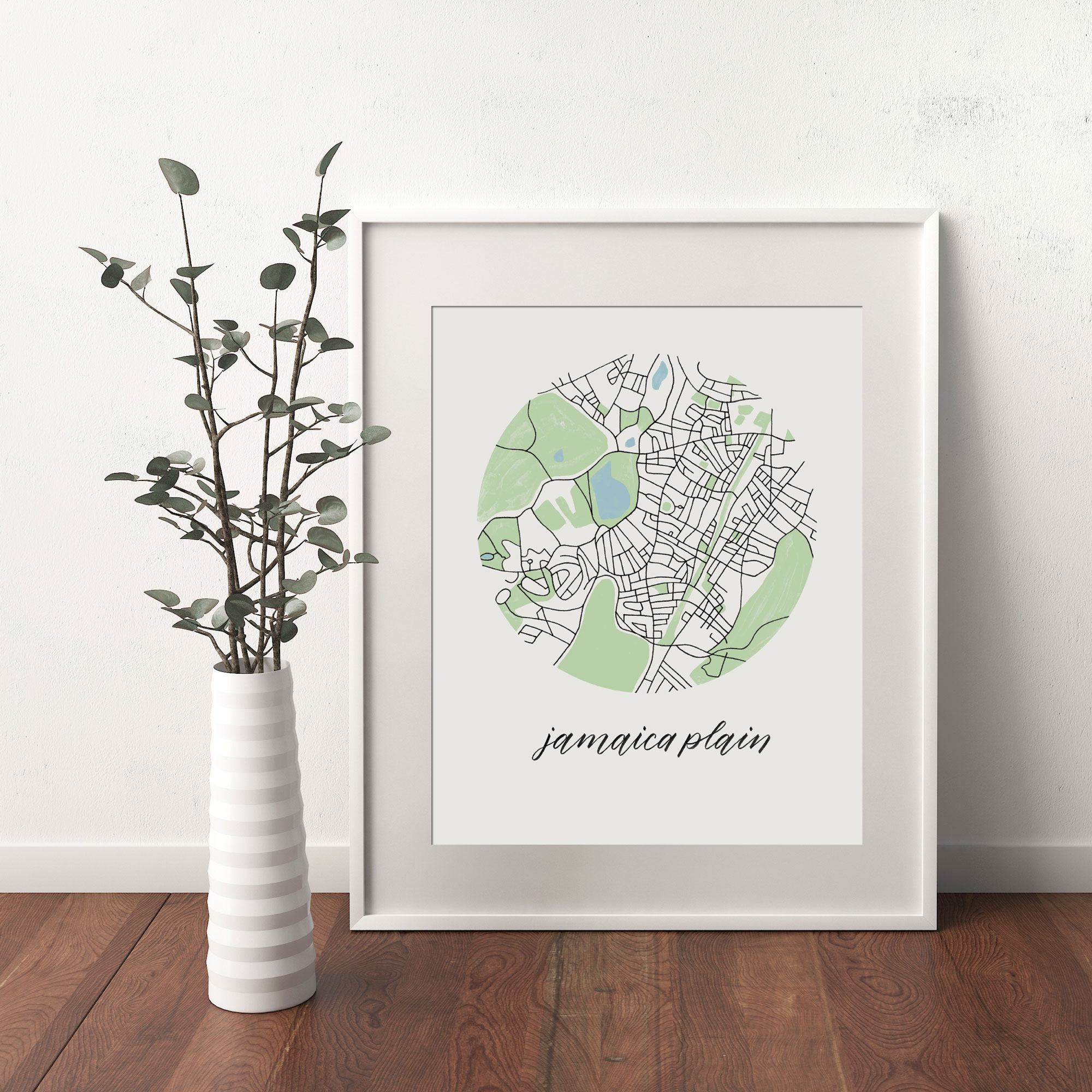 Jamaica Plain, Boston Map print framed and leaning on white wall next to dried leaves in a vase