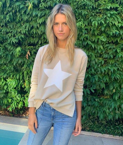 tan sweater white star