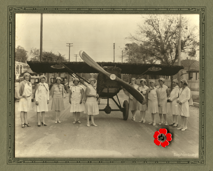 "American Legion Auxiliary, Post 179, ""Poppy Plane"" for Armistice Day Parade, c. 1920L to R: Fay Peterson, Norma Tolle Wrage, Erna Nuhn, Irene Sippel Wayland (Whalen), Dora Roessing Tietze, Elsie Roessing Pfeuffer, Valeska Roessing, Barbara Hoeke Fischer, Ottilie (Ottie) Coreth, Norma Roessing Zipp."