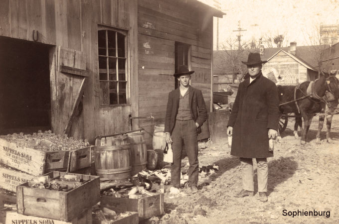 Photo Caption: Robert Posey, right, looks over damage to St. John's Bottling Works after severe freeze on Feb 13, 1905.