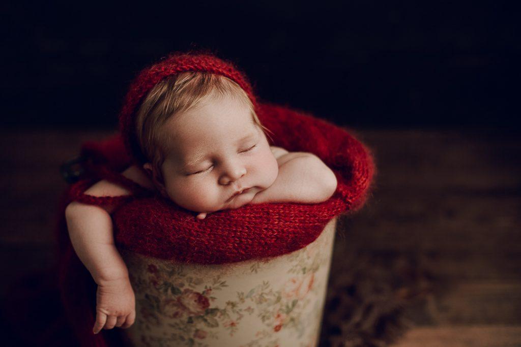 newborn photography studio Vancouver Island baby sleeping in bucket with arm dangling