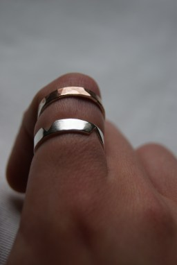 Copper ring with silver solder inlay and silver ring.