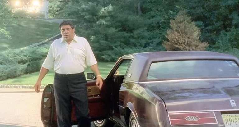 Pussy Bonpensiero standing outside his car