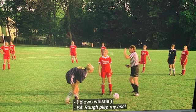 Meadow Soprano's soccer team is on the field playing.
