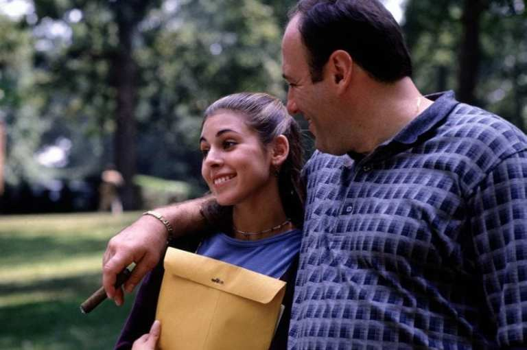 Tony and Meadow Soprano walking outside while on their college tour