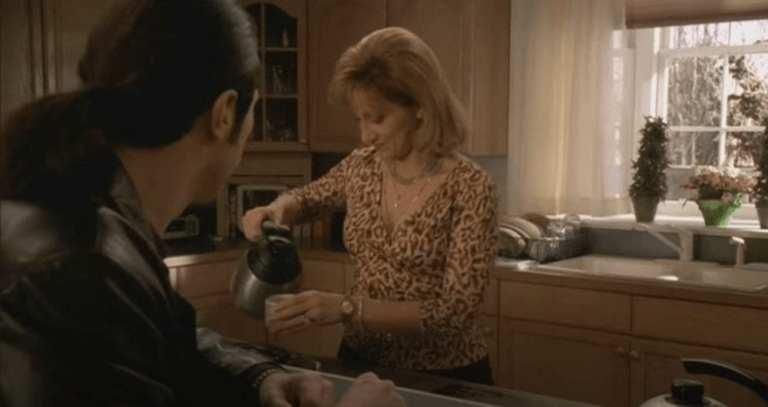 Carmela & Furio drink coffee