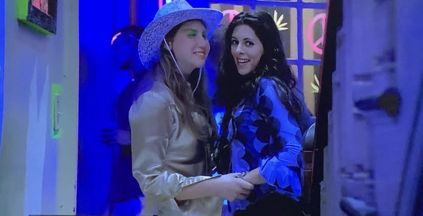 Meadow and Caitlin at the club at college.
