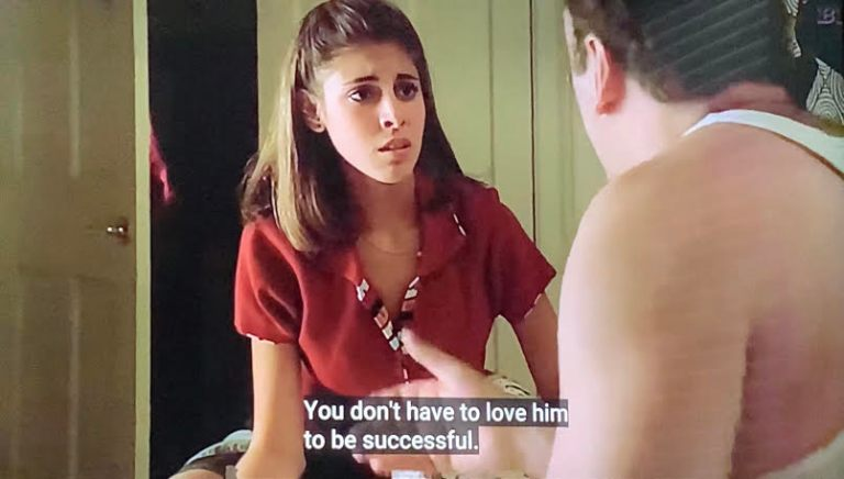 Meadow and Tony Soprano sitting on Meadow's bed talking about Meadow's soccer coach, Coach Hauser.