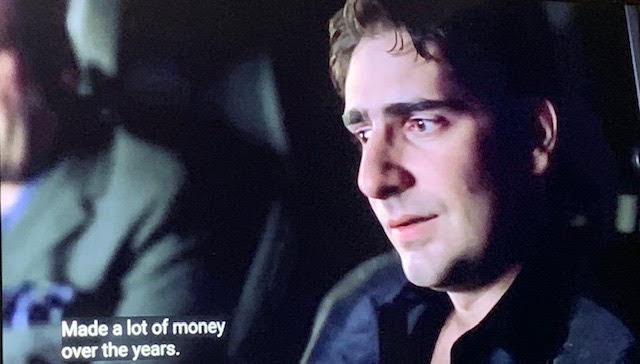 Christopher Moltisanti in the car with Tony looking at Barry Haydu, the retired policeman.
