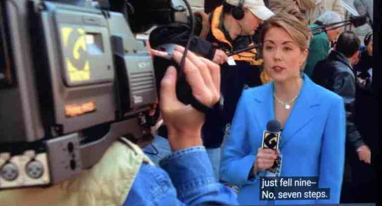 Junior falls down seven steps as a reporter asks him a question.