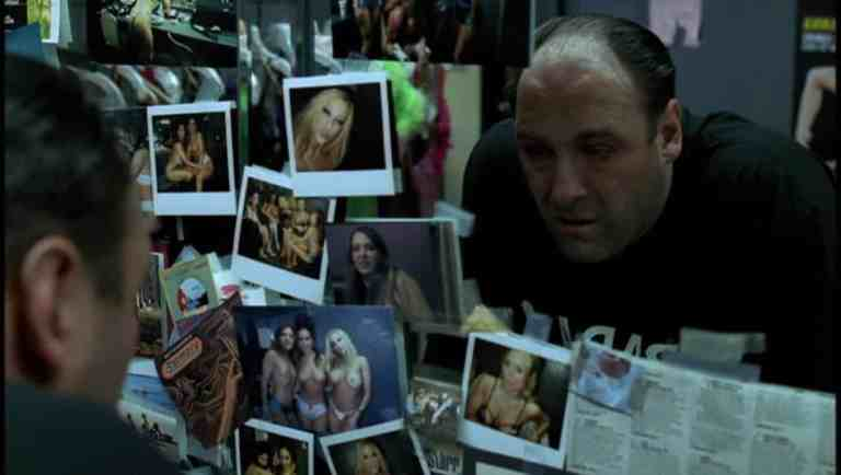 Tony is staring at pictures on the wall in the dressing room and sees one of Tracee.