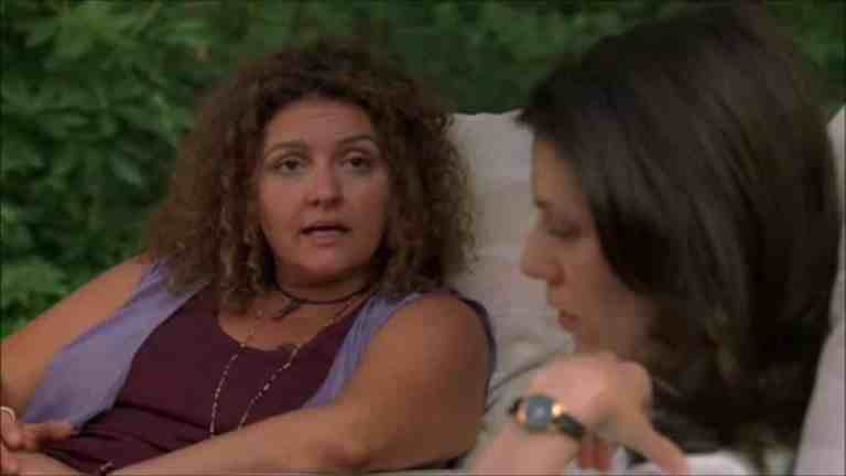 janice and barbara soprano are sitting and talking out by the pool at the Soprano residence.