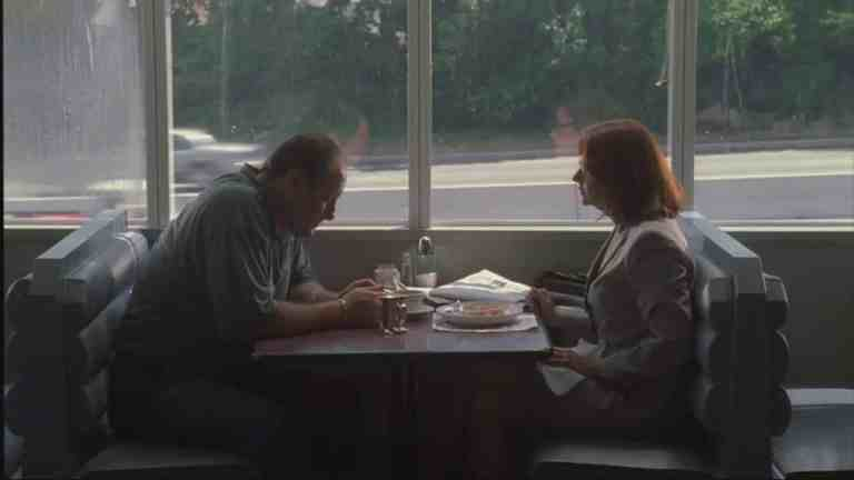 Dr. Melfi and Tony are sitting at a table together in a diner.