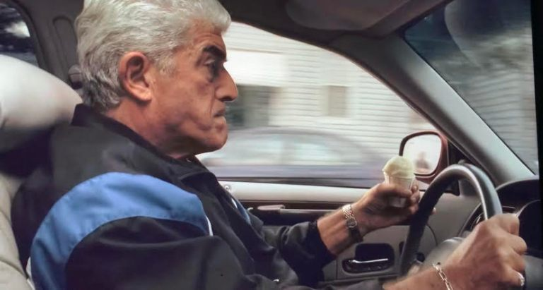 Phil Lotardo is holding an icecream cone in his hand while driving in the car trying to get away from Tony.