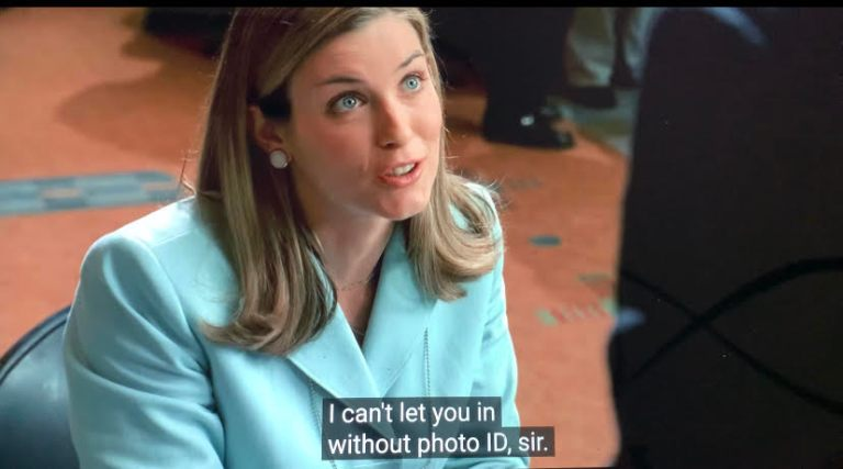 a woman is denying tony soprano entrance to a convention because he doesn't have the right identification.
