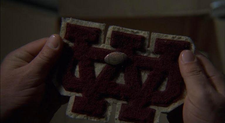 Tony's varsity athlete highschool badge.