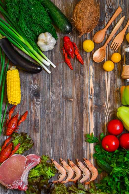 vegetables and tomatoes on cutting board