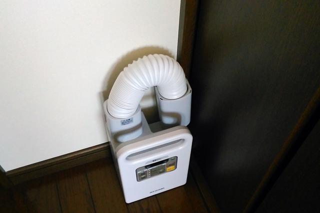 布団乾燥機11