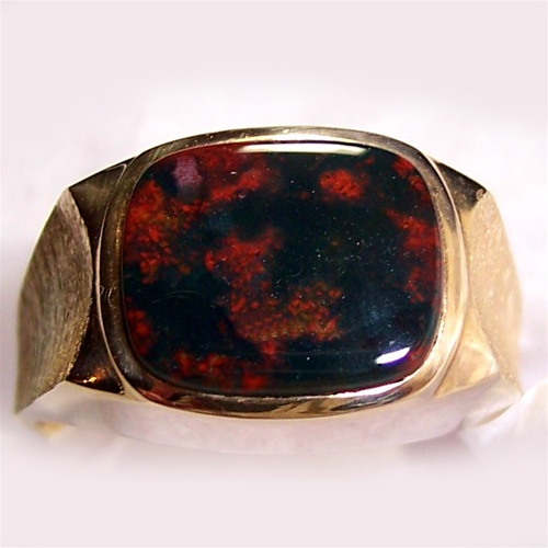 A bloodstone ring with a gold setting