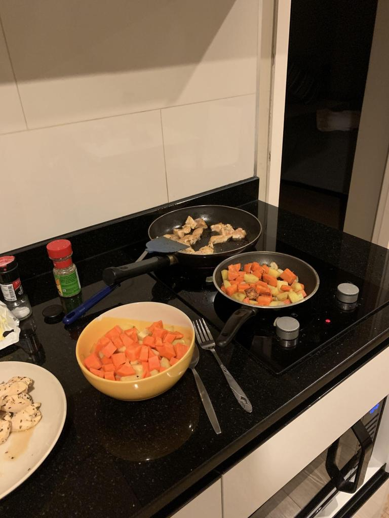 AirBnB in Bangkok, Thailand - chicken, carrots, and potatoes on the stovetop!