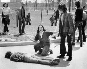 The iconc shot of the Kent State shootings. The girl is Mary Ann Vecchio, a 14-year old Runaway who sold the rights to her story for a bus ticket to California.