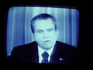 Nixon resigns on TV.