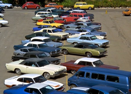 The establishing shot of a parking lot offers a snapshot in time of 1974. Look at all that Detroit iron.