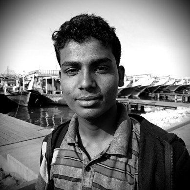 "Anur said he is '18-19 years-old '. He came from Chittagong, Bangladesh almost one and a half years ago to work as a fisherman. ""I couldn't dream to get a job back home that brings me this salary. Now I can make plans to marry and have a family, but not soon. I will not go home for the next 3-4 years, I want to save the money I make. I am happy I can help my family now as well "" he said. He was keen to tell me he is proud with his job and Bangladeshi are the best fishermen in the world. He also insisted I should quit smoking."