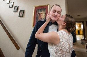 Groom kissed by bride by Sorrells Photography