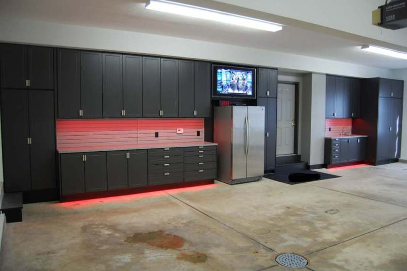 garage design with concrete garage floor and garage storage or garage cabinet