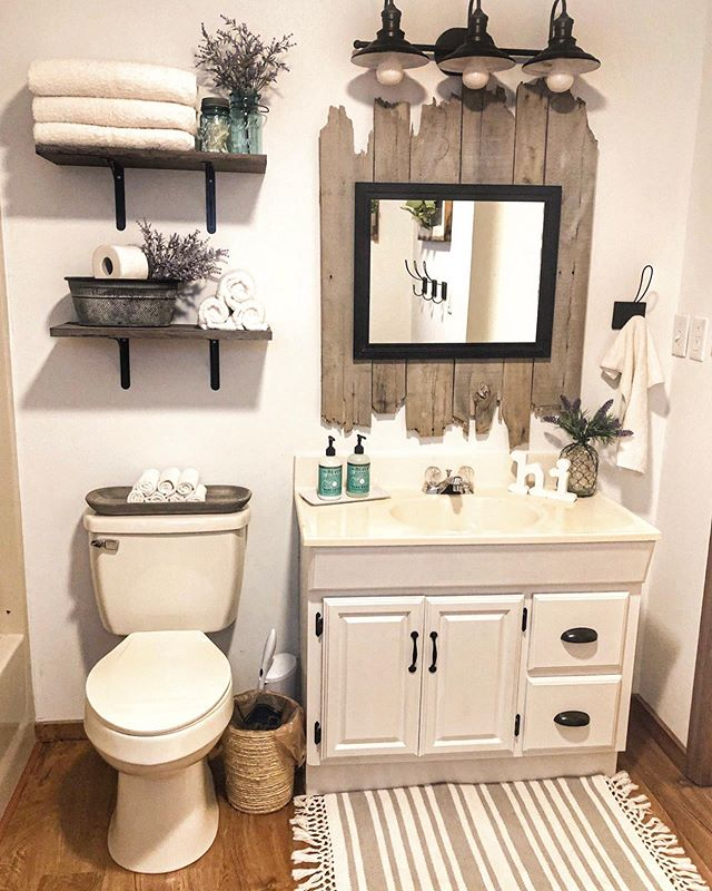 Clean White rustic bathroom with wood wall accents