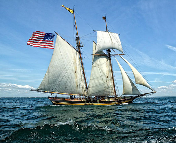 Schooner on Chesapeake Bay flies the 15-stripe/15-star flag that flew over Fort McHenry. Image from the Maryland Secretary of State's Office